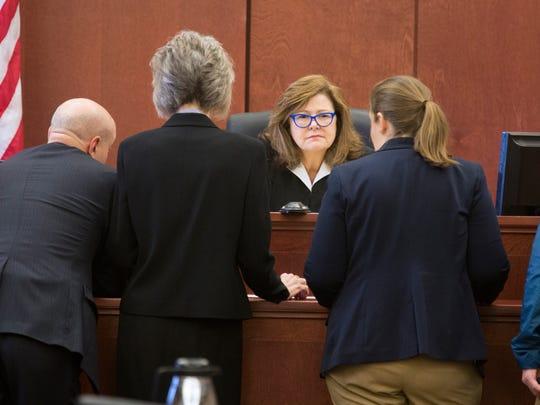 Kenton Circuit Judge Kathleen Lape talks to attorneys