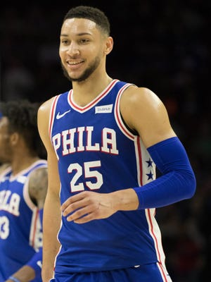 Philadelphia 76ers guard Ben Simmons reacts after recording a triple double during the fourth quarter against the Charlotte Hornets.