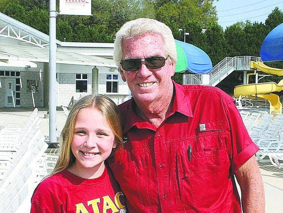 ATAC coach and staff member Gerry Norris stands with Moultrie swimmer Meg Howell after practice last year.