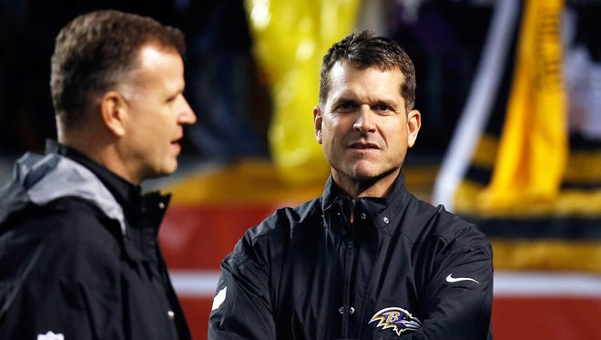 Jim Minick is pictured with Jim Harbaugh when they attended a Ravens game in January.