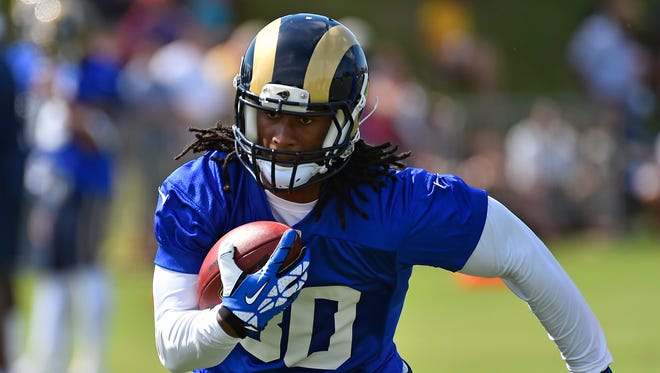 St. Louis Rams running back Todd Gurley (30) runs with the ball at Rams Park.