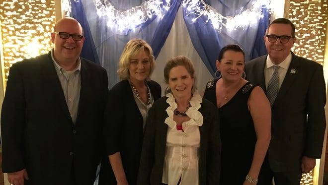 Enjoying the Rescue Mission's 46th Anniversary Gala are director of programs Tom Cox, executive director Darla Burkett, associate director Sue Meyers, Sandy Rhoades and board chairman Floyd Rhoades.