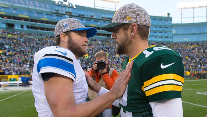 Detroit Lions quarterback Matthew Stafford (9) greets Green Bay Packers quarterback Aaron Rodgers (12) following a game.