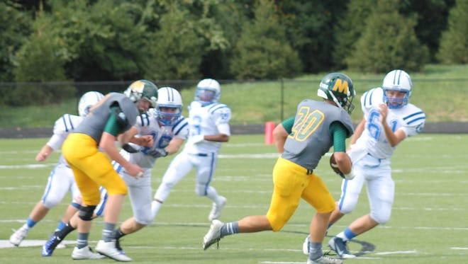 McNicholas junior Sam Browning (20) takes off for the Rockets on a punt return against Wyoming.