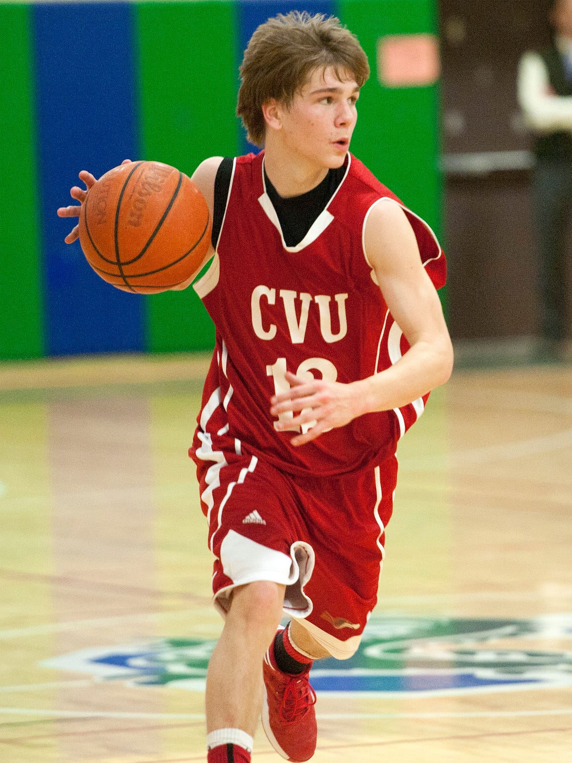Champlain Valley's Richard Baccei dribbles down the