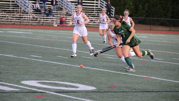 Caroline Cahill carries ball up field vs. Garden City