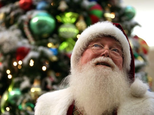 """The Santa Claus at the Ocean County Mall has been there for about a decade. We will discuss with """"Santa"""" why he keeps coming back to Ocean County year after year, how the children have changed, what are the strangest requests he has received from children, do some kids really lose control of their bladder as the immortalized in the movie classic """"A Christmas Story,"""" and what does Santa do to prevent children from pulling on his whiskers. Toms River, New Jersey. Saturday, January 24, 2015. David Gard /Correspondent"""