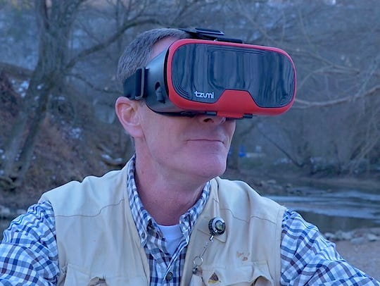 Randy Ludwig is shown wearing a virtual reality headset