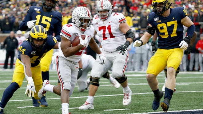 Ohio State running back JK Dobbins scores a touchdown during the second quarter at Michigan on Nov. 30.