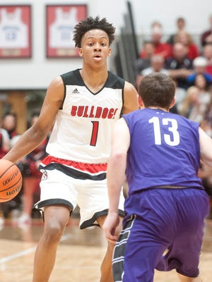 New Albany guard-forward Romeo Langford looks to get past Bloomington South guard Luke Jager. 