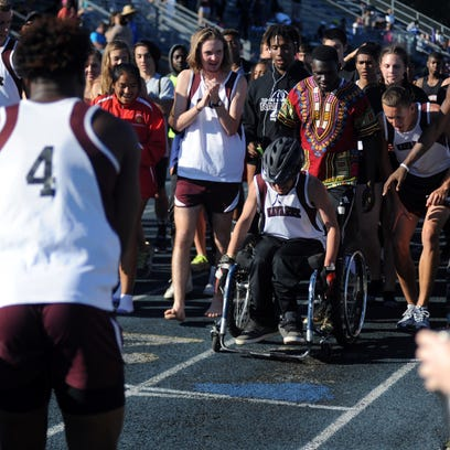 Navarre freshman Ethan Fulk wheels to the finish line