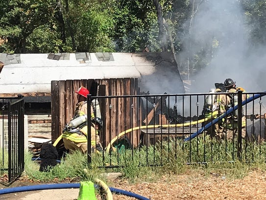Redding firefighters put out a fire that burned a detached