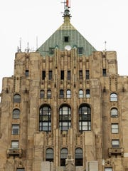 The Fisher Building, built in 1928 on W. Grand Blvd., is known for its golden tower and Art Deco style.