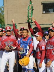 Chinese Taipei celebrates with the trophy.