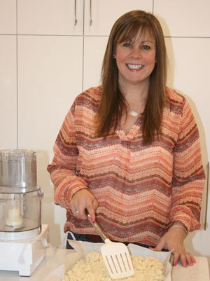 Sarah Millhollin assisting with the roasted garlic-salt mixture for the 3-1-1 seasoning.