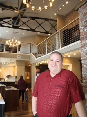 Wayne Stephens, owner of W. Stephens Cabinetry, stands in the lobby of his newly remodeled building.