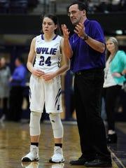 Wylie head coach Kurt Richardson talks with Mary Lovelace