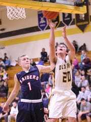 Old Fort's Jacob Webb tries to get a shot on the glass while drawing a foul.
