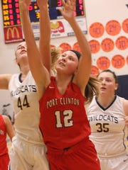 Port Clinton's Abby Decker and Woodmore's Brooke Allen fight for a rebound.