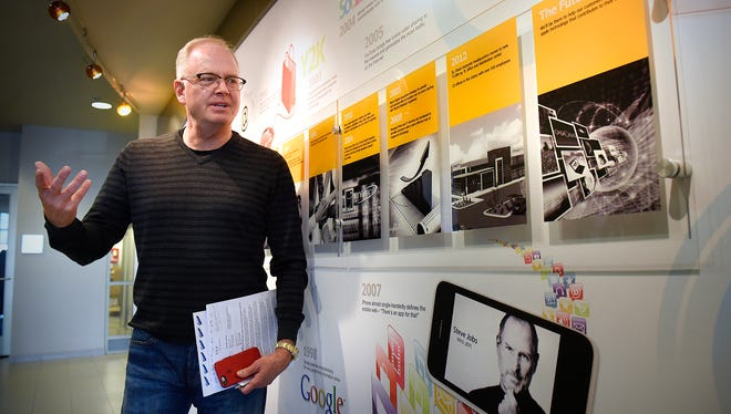 Marco CEO Jeff Gau talks about the company near a display on the firm's history at the Marco headquarters building in St. Cloud.