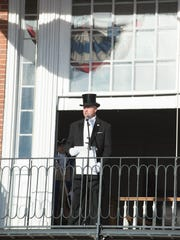 Kirk Lawson, Town Crier, reads the election results at Return Day in Georgetown.