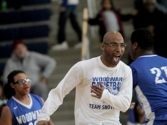 Woodward's  head coach Jerrell Redden  celebrates during
