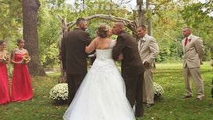 The gesture between father and step-father at this wedding will have you smiling.