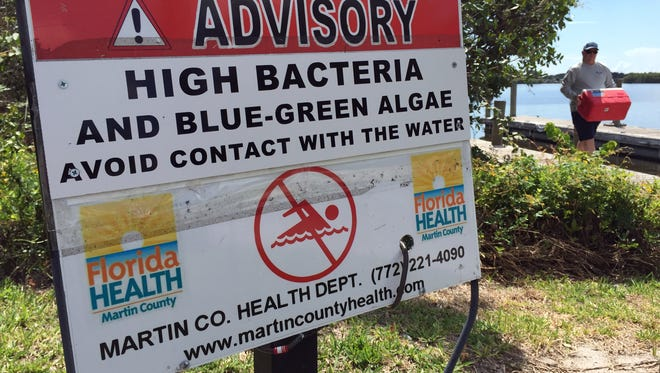 Signs warning of high bacteria levels and algae blooms line the boat ramp and fishing pier Tuesday at Leighton Park in Palm City. Algae blooms are spreading into the main channel of the St. Lucie River, past downtown Stuart to the northern end of Sewall's Point. (MOLLY BARTELS/TREASURE COAST NEWSPAPERS) Taken: Tuesday, May 31, 2016