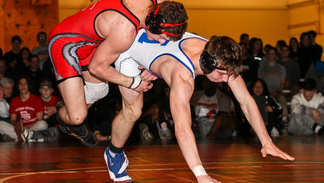 Bound Brook's Joe Casey, left, wrestles Holmdel's Scott Dupont at 152 pounds in the Region 5 wrestling finals at Hunterdon Central High School in Flemington on February 24, 2018. (Photo by Keith Muccilli, Correspondent)
