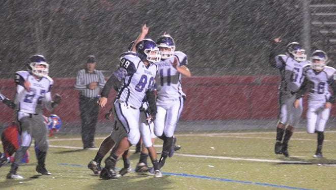 Mitchell's Alex McKinney is congratulated after a touchdown catch last Friday.