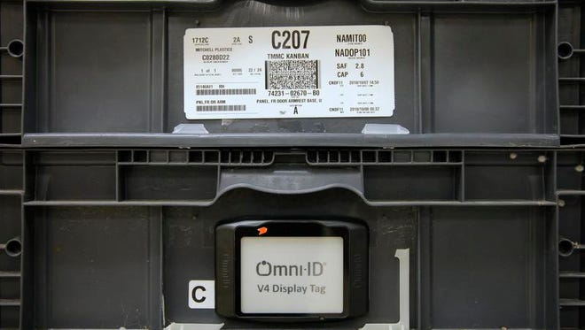 Omni-ID makes these view tags called the Pro View system, bottom, to replace paper tags, top, for manufacturing use.