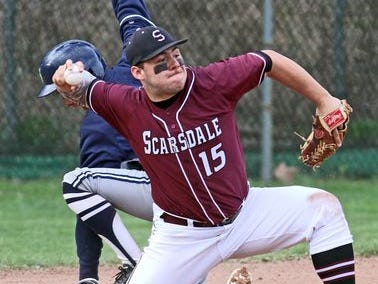 Scarsdale third baseman Tyler Mandel makes a throw during Suffern 's 7-5 win in a varsity baseball game at Scarsdale High School April 23, 2015.