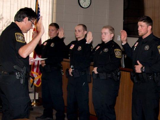 Marathon County Sheriff Scott Parks swears in seven new deputies on July 21.