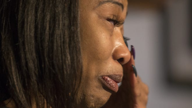 Erica Bailey, daughter of Aaron Bailey, fields reporters' questions after the announcement that no charges filed against IMPD officers Michal P. Dinnsen and Carlton J. Howard who fired their weapons at Aaron Bailey, resulting in his death during a traffic stop earlier this Summer, Indianapolis, Tuesday, Oct. 31, 2017.