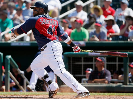Cleveland Indians' Carlos Santana watches his two-run double during the second inning of a spring training baseball game against the Seattle Mariners on Tuesday, March 31, 2015, in Goodyear, Ariz. (AP Photo/Ross D. Franklin)