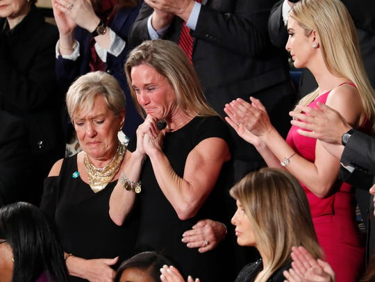 An emotional Carryn Owens is acknowledged by President