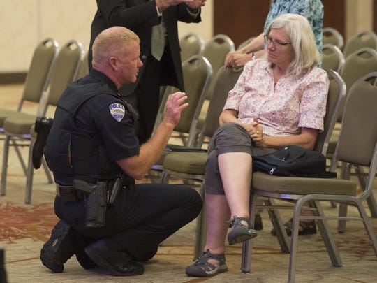 Fort Collins Assistant Police Chief of the Patrol Division Kevin Cronin speaks with City Park Neighborhood resident Linda Joyce after a meeting held for City Park Neighborhood residents to hear from city and police leadership after the murder of Heather Hoffman and subsequent arrest of suspect Jeffrey Etheridge, Thursday, July 13, 2017, at the Lincoln Center in Fort Collins, Colo.