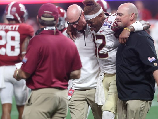 FSU's Deondre Francois is helped off of the field after