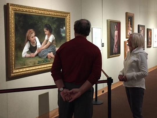 "Don Newport and Cathy O'Connor admire the Detroit Institute of Arts' ""The Nut Gatherers"" by William Adolphe Bouguereau, on view at the Alden B. Dow Museum of Science & Art in Midland on Nov. 2, 2015."