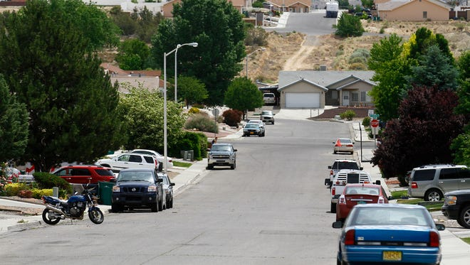 Cars are seen parked along the street on Monday along Wellington Street in Farmington. Police are asking Farmington residents to lock their cars to defend against a rash of burglaries.