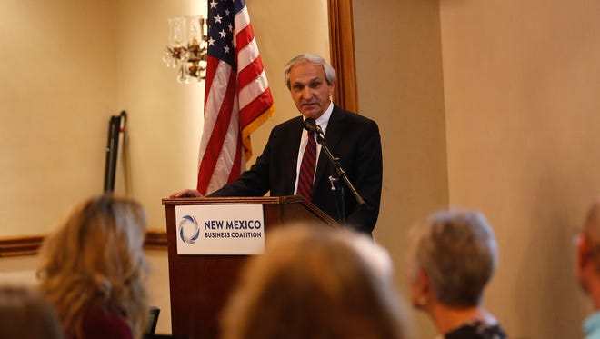 Secretary of New Mexico Energy, Minerals and Natural Resources Department Ken McQueen speaks on Thursday at a New Mexico Business Coalition event at the Courtyard by Marriott in Farmington.