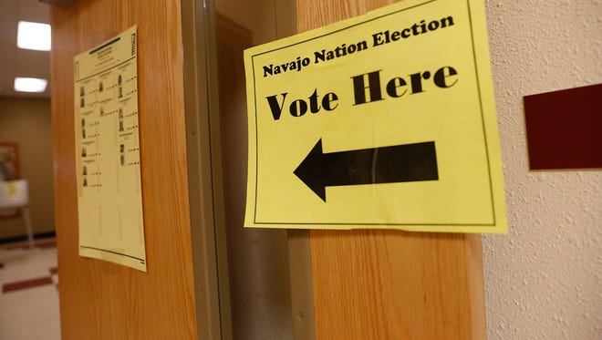 A sign directs Navajo voters to a polling station Nov. 8 in Upper Fruitland. The filing period for many Navajo Nation offices, including the presidency, begins Thursday.