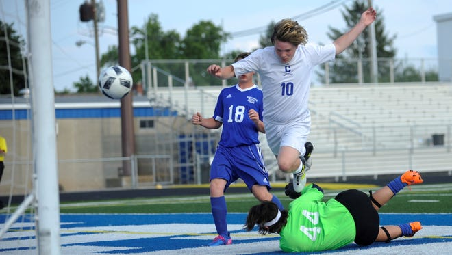 Chillicothe's John Graves hurdles Washington Court House's goalie after sending a ball to the back of the net during the first half of a Cavaliers' 14-0 win over the Blue Lions last week.