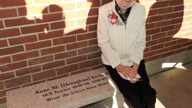 Former Hubbardston Center School teacher Anne Richard sits on the bench placed in her honor.