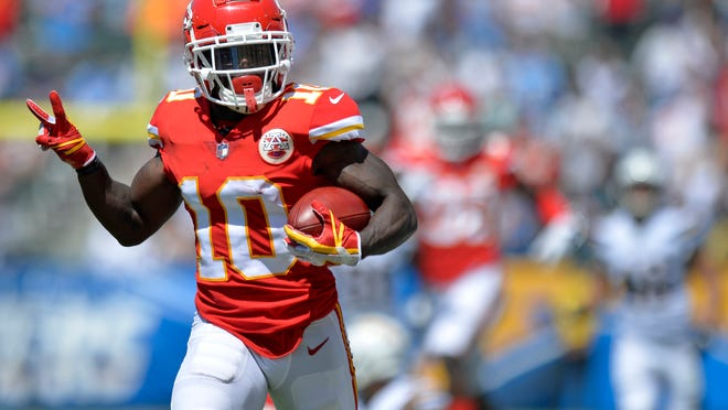 Sep 9, 2018; Carson, CA, USA; Kansas City Chiefs wide receiver Tyreek Hill (10) returns a punt for a touchdown during the first quarter against the Los Angeles Chargers at StubHub Center. Mandatory Credit: Jake Roth-USA TODAY Sports