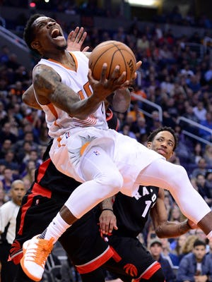 Dec 29, 2016; Phoenix, AZ, USA;  Suns guard Eric Bledsoe (2) drives the ball against the Raptors in the second half of the NBA game at Talking Stick Resort Arena. The Suns won 99-91.