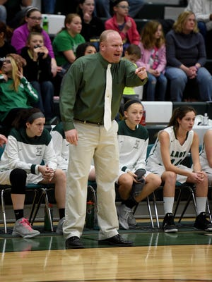 Coach Jerimy Stephan watches game action Saturday, Feb. 4, 2017, during the girls basketball sectional championship in Lynn.