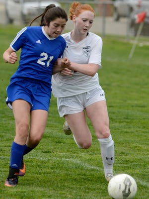 Nordhoff High School's Leslie Perez (left) and Grace Brethren's Emma Hopkins challenge each other for control of the ball during Thursday's CIF-Southern Section Division 6 first-round match at Grace Brethren. Grace won 5-0.