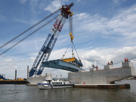 The Left Coast Lifter moves a girder assembly into place over a concrete support pier for the new Tappan Zee Bridge June 17, 2015.
