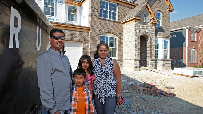 The Swamy family, outside of their new home, under construction in suburban Mason. Such non-urban development is still incredibly popular in Greater Cincinnati – particularly in Warren County – for multiple reasons.